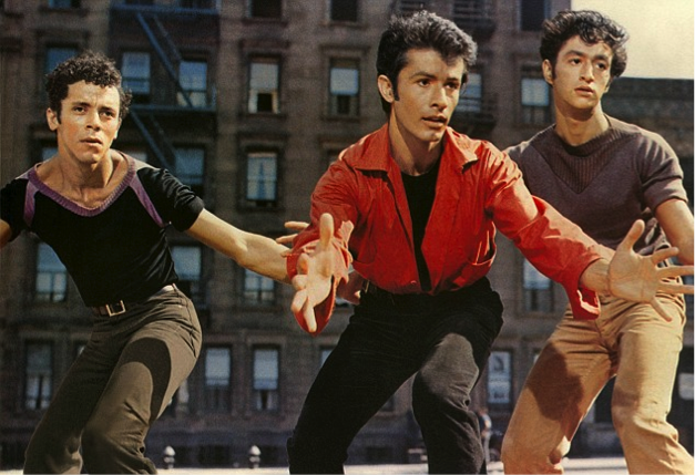 Bernardo (center) and the Sharks, dancing in the streets (West Side Story, United Artists)