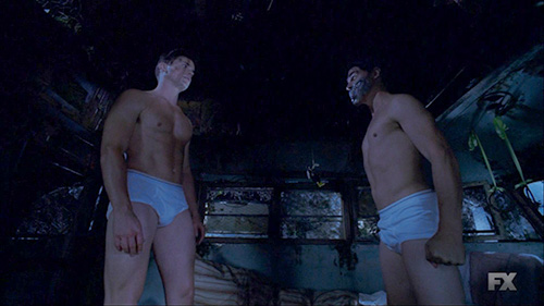 Andy forgot his mask. (Matt Bomer and Finn Wittrock, American Horror Story: Freak Show, FX)